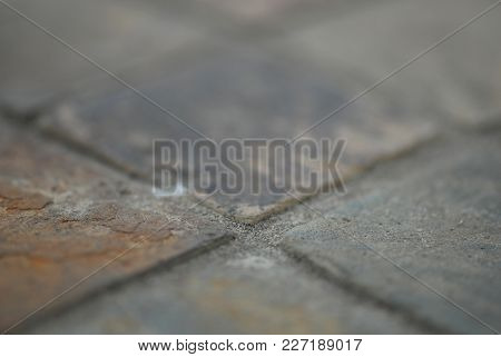 An Abstract Image Showing The Corners And Rough Surface Of Tile And Grout.