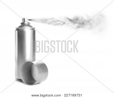 Spraying paint from can on white background