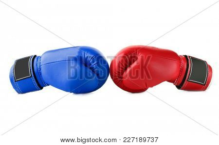 Red and blue boxing gloves on white background. Concept of political confrontation between American major parties