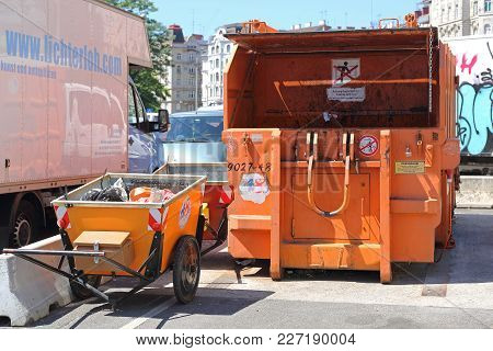 Vienna, Austria - July 11, 2015: Press Container Compactor Big Industrial Waste Disposal Hydraulic B