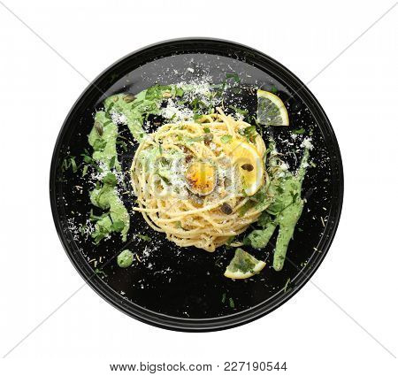 Delicious pasta with egg yolk and sauce on white background
