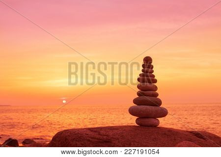 Stones Balance On A Background Of Sea Sunset. Calm And Meditation. Concept Of Harmony And Balance