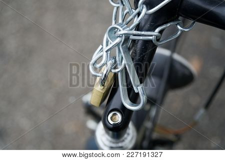Padlock Bicycle Lock Close-up Lock With Security Chain Attached.