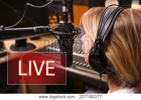 Young woman taking part in live radio broadcast at modern studio