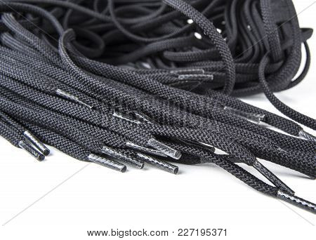 Black Spare Shoe Laces On The White Background