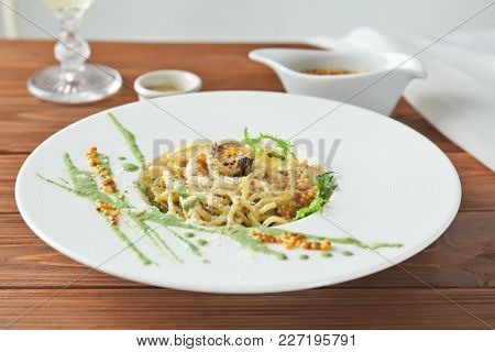 Delicious pasta with egg yolk and sauce on plate