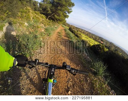 Pov Of A Mountain Bike Going Downhill On A Dirt Path
