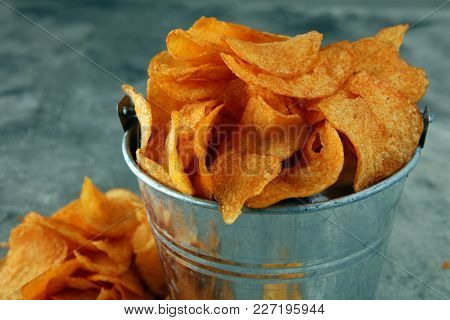 Crispy Potato Chips. Paprika Chips On Table. Spicy Crunchy Chips