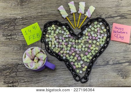 Cup And Chain Shape Of Heart With The Word 14th February And Marshmallows
