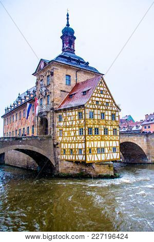 Old Town Hall (altes Rathaus) In Bamberg,on The River Regnitz, While It Snowsgermany