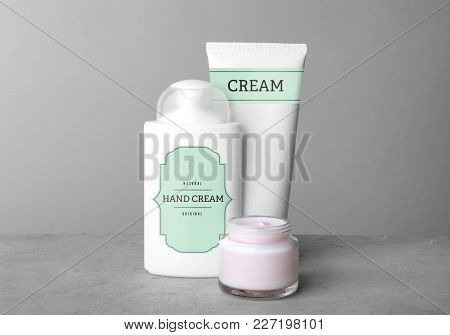 Body cream set on table against grey background