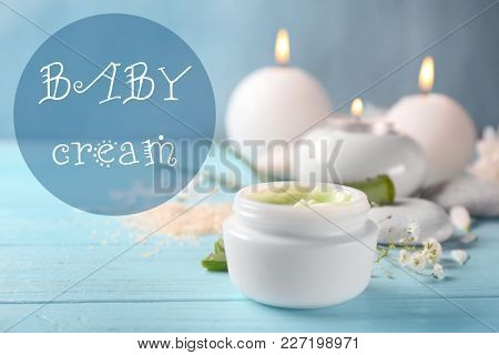 Jar with baby body cream on wooden table