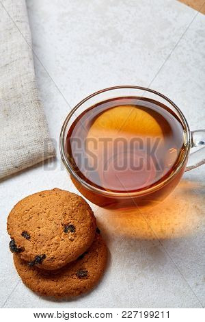 Some Black Or Herbal Tea In Transparent Cup With Tasty Biscuit Cookies On Light Grey Burlap Cotton N