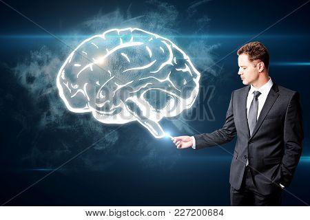 Handsome Caucasian Businessman Drawing Creative Brain Sketch On Digital Background. Brain Storm And
