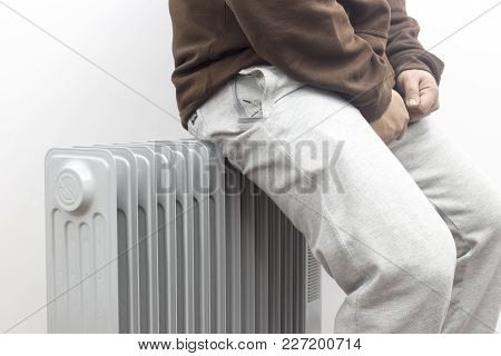 The Freezing Man Heating And Relaxing On Oil Heater