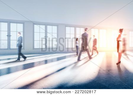 Businesspeople In Abstract Blurry Office Interior With Sunlight. Meeting And Corporate Concept. 3d R