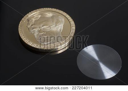 Gold Bitcoin Virtual Coin On A Black.