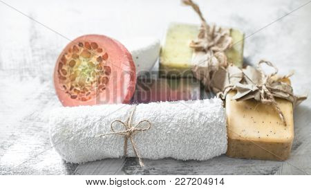 Spa Composition With Handmade Soap In A Beautiful Stand On A Light Background
