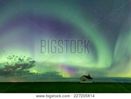 Swirl Of Aurora Borealis Northern Lights Over The Historical North Saskatchewan Landing School Estab