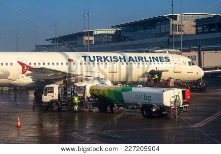 Hamburg, Germany - February 09, 2018: The Plane At The Airport Is Fueled. Fuel Is Supplied From A Ta