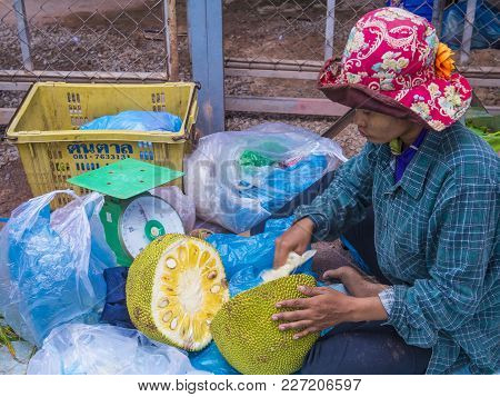 Siem Reap , Cambodia - Oct 18 : Cambodian Woman Selling Jackfruit In A Market In Siem Reap Cambodia