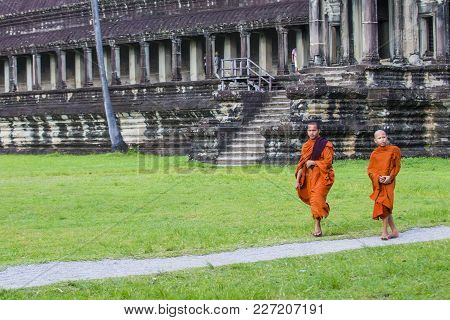 Siem Reap , Cambodia - Oct 17 : Budhist Monks At The Angkor Wat Temple In Siem Reap Cambodia On Octo