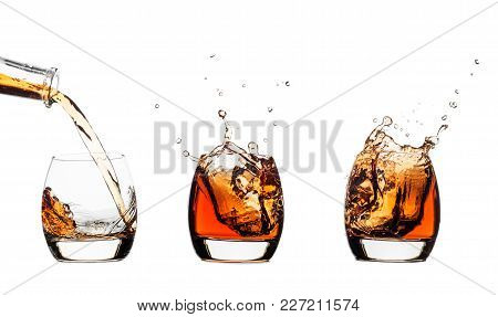 Set Of Whiskey Splash With Ice Isolated On White Background