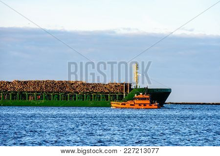 Cargo Ship Is Leaving Port Sailing Away