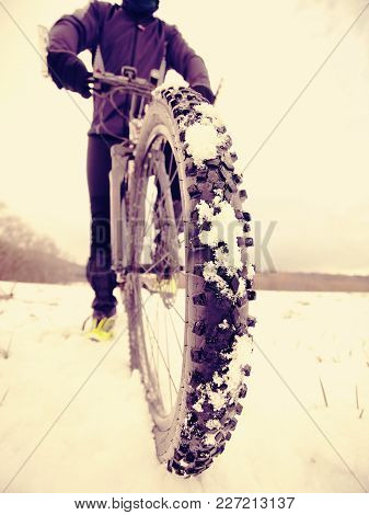 Cyclist Man With Winter Bike Stays In Snow. Winter Extreme Sport, Sportive Concept.
