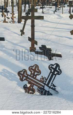 Image Of Orthodox Crosses On Abandoned Graves In The Old Cemetery In Winter