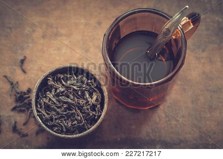 Vintage Mug Of Tea And Rustic Metal Cup Of Dry Tea Leaves. Top View.