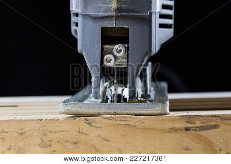Carpentry Tools On A Wooden Workshop Table. Saw And Other Carpentry Accessories While Working In A C
