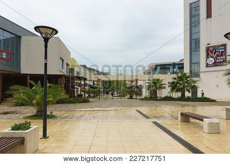 Territory Of Mandarin Shopping And Entertainment Center In Adler. Cloudy Day In Early Summer
