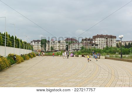 Russia, Sochi, Krasnodar Region-june 07.2017: Vacationers On The Picturesque Blooming Promenade Of A