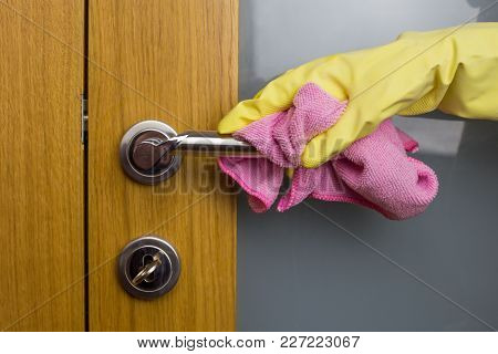 Housewife Work, A Housewife Carries Out Her Job, Is Clean With A Cloth In Her Hand, And Gloves On He