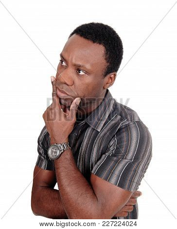 A Close Up Image Of An African American Man Looking Away With One Hand On His Chin, Isolated For Whi