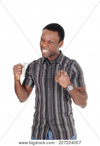 A Young Handsome African American Man Standing In A Striped Shirt With His Fists And Smiling Of Vict