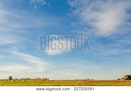 Yellow Green Field With Haystacks, Farmer's House With Outbuildings,