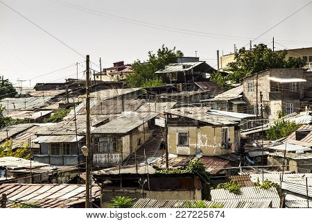 View Of Yerevan. A Cluster Of Old Poor Buildings Near The Cathedral In The Capital Of Armenia Yereva