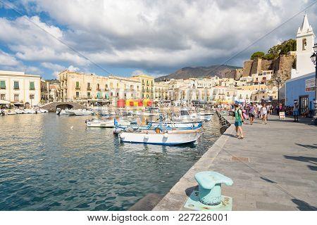 Lipari, Aeolian Islands, Italy - August 22, 2017: Tourists Wait For Their Ship In Marina Corta On Li