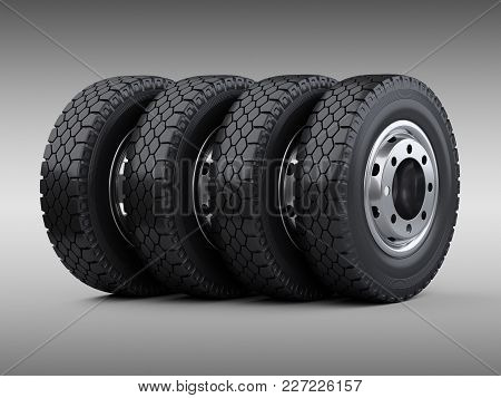 Set Of Four Big Vehicle Truck Tires Stacked. New Car Wheels With Disk. 3d Illustration Over Grey Bac