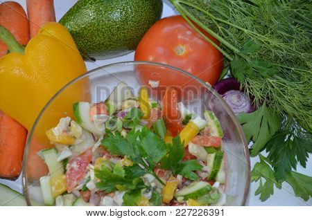 Vegetable Salad With Avocado, Tomato, Sweet Peper And Greens On The White Background. Raw Food, Vege