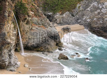 Fresh Water Falls Into The Pacific Ocean At Mcway Falls