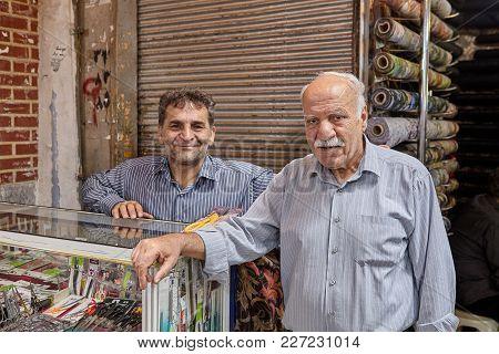 Tehran, Iran - April 29, 2017: Tehran, Iran - April 29, 2017: Market Traders Of Fabrics In The Main