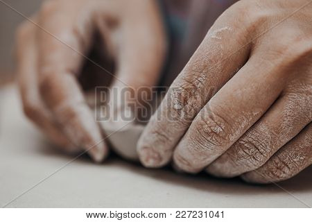 Female Potter Works With Clay, Craftsman Hands Close Up, Kneads And Moistens The Clay Before Work, S