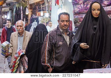 Tehran, Iran - April 29, 2017: One Mature Man Stands Next To The Mannequin Of A Muslim Woman In A Bl