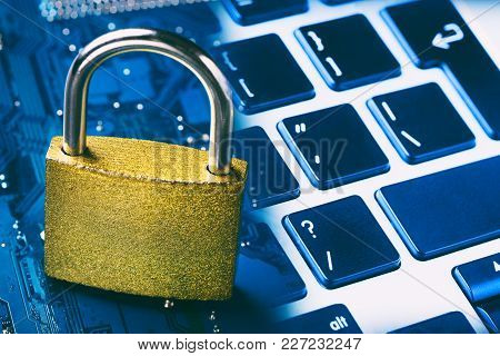 Padlock On Computer Motherboard And Keyboard. Internet Data Privacy Information Security Concept