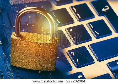 Padlock On Computer Motherboard And Keyboard. Internet Data Privacy Information Security Concept. To