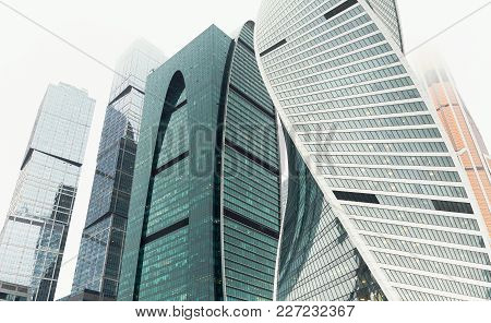 Skyscrapers In The Financial District. Modern Office Buildings Against Sunny Sky, Low Angle View. Bu