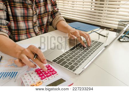 Businessman Calculate About Cost And Doing Finance At Office, Finance Managers Task,concept Business